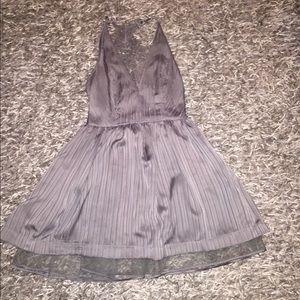 BEBE Grey/silver illusion lace back dress